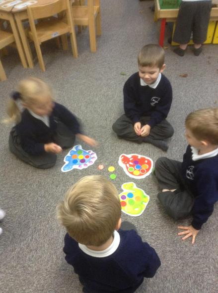 We are learning to play games with our friends and follow the rules