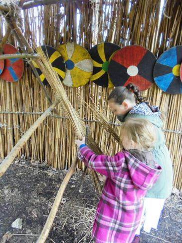 Thatching the roof, great teamwork!