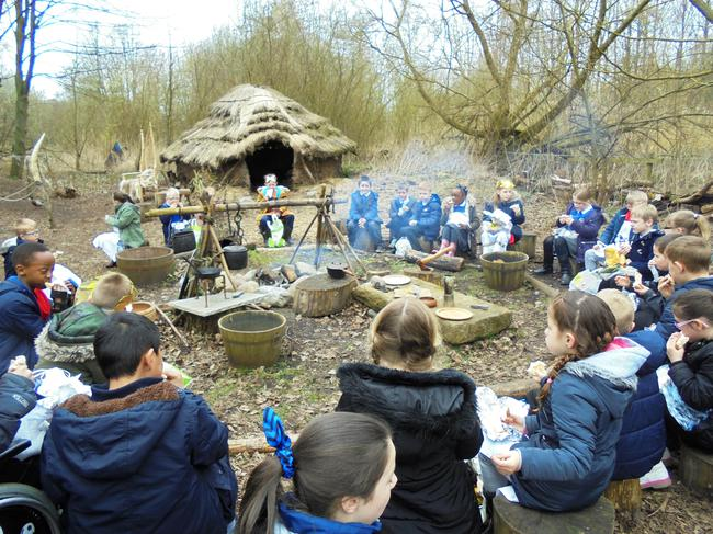 A well earned lunch around the campfire.