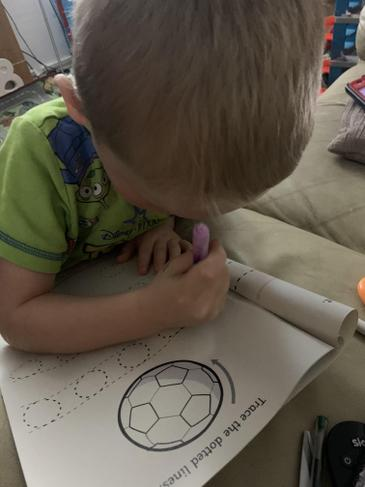 Aston has been busy completing his work at home.