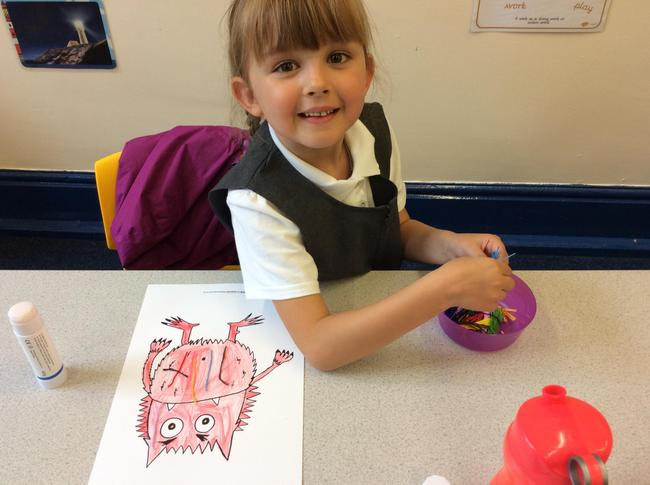 Using coloured threads to make a furry monster!