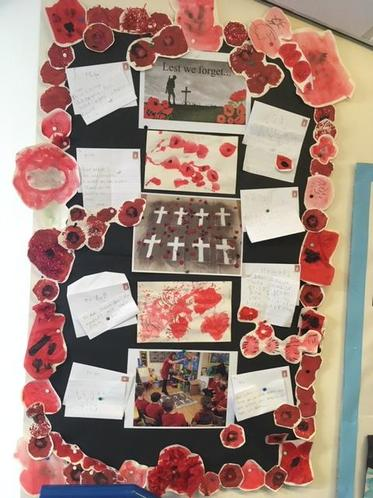 Remembrance poppies and letters to fallen soldiers