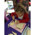 The other pictures show them cutting cheese and buttering bread for their cheese toasties.