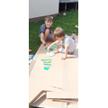 Isaac and Harry busy making their caterpillar.