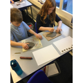 Rolling clay to make our Tesserae