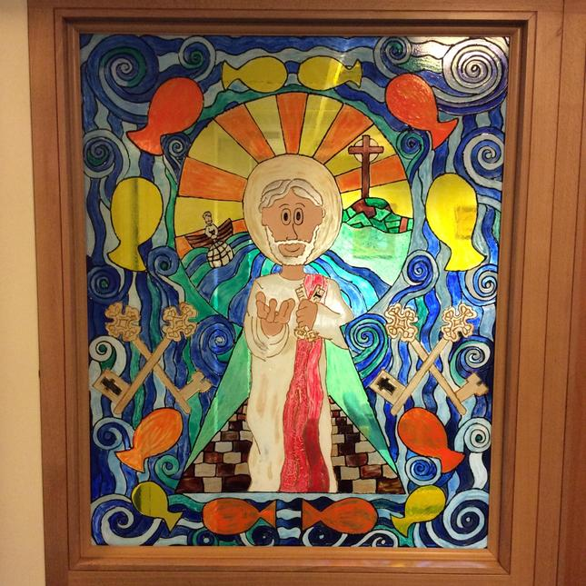 Our St. Peter stained glass window is in the school entrance to welcome everyone.