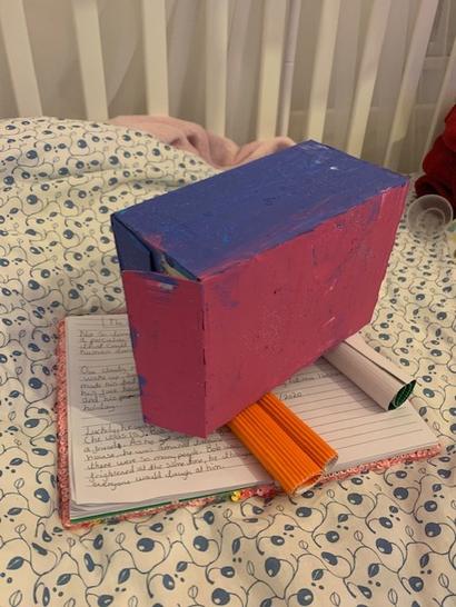 Sarah made this car from a cardboard box.
