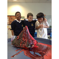 We created chemical reactions to make our volcanoes erupt...