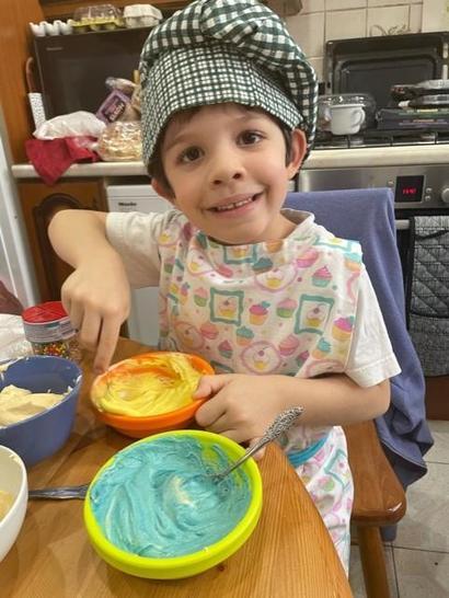 Martin making his rainbow cupcakes