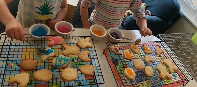 Making Easter biscuits to give to their neighbours