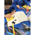 Children making their own mosaic tiles