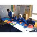 Children making their own mosaic tiles