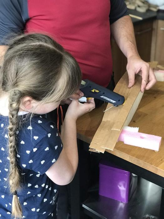 Eva using a glue gun