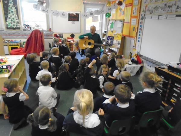 Rev Richard came in to teach us some songs