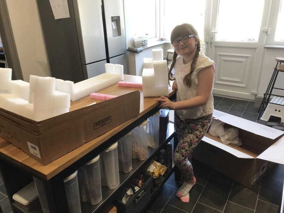 Eva selecting her materials