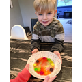 This child did another rainbow experiment using skittles!