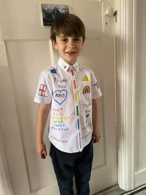 Charlie decorates his school shirt in support.