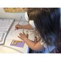 Lili practising writing number 9.