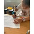 Bianca practising her writing!