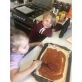 Mimi making pizza for dinner!