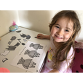 Lili dressing the little pigs!