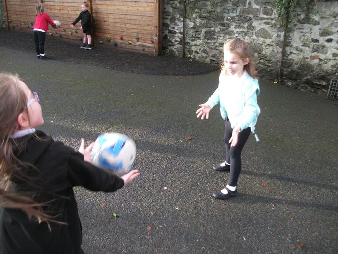 Practising our throwing and catching skills in PE