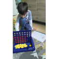 Alex using connect 4 to make arrays.