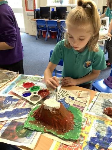 Painting the detail onto our mountains.
