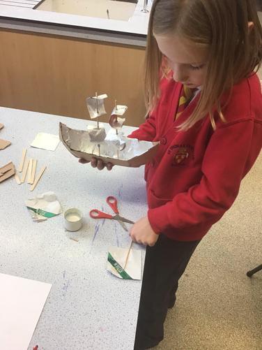 Making model boats.