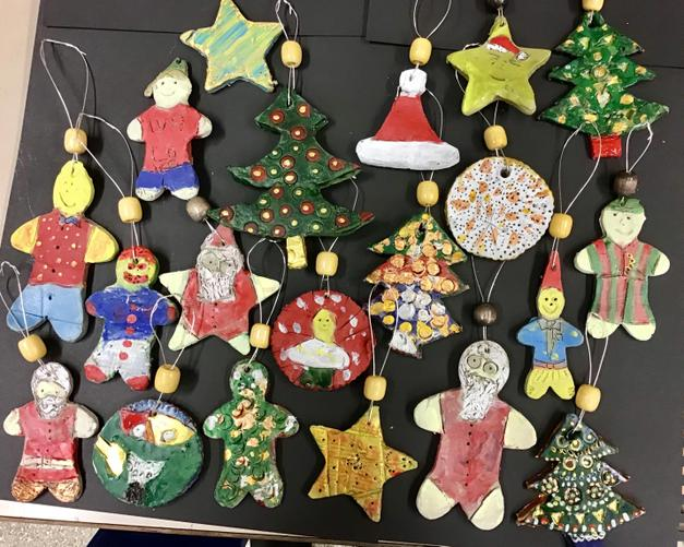 Making clay Christmas decorations.