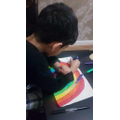 Adam taking his time colouring