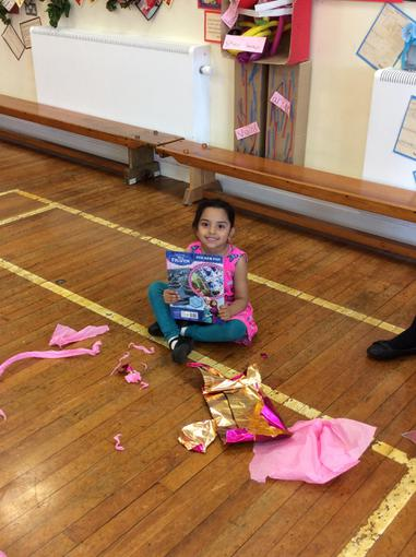 Alesha won the pass the parcel.