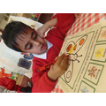 Ramzan is completing a butterfly maths puzzle.