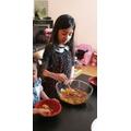 Alayna baking her buns