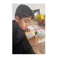 Rohaan is busy writing.