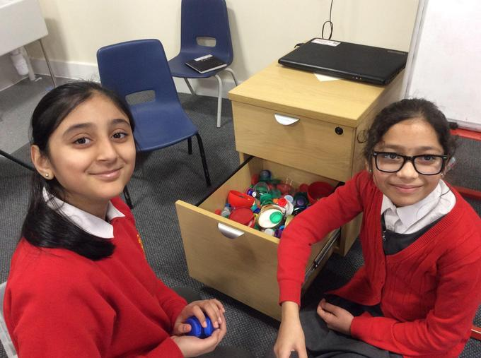 Look at how many bottle tops we have collected.