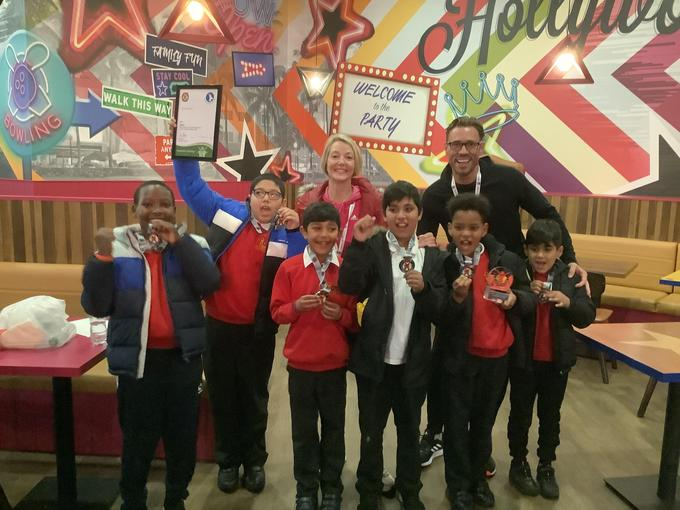 Proudly showing our silver medal and trophy!