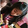 Alayna designing phone cases