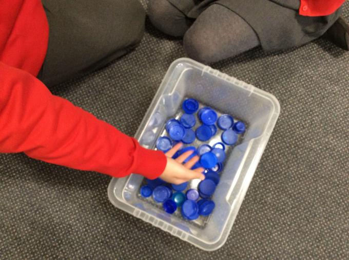 Sorting out our bottle tops for the display.