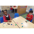 Using plasticine to create Christian artefacts.