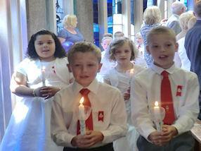Candle lit procession at the beginning of Mass.