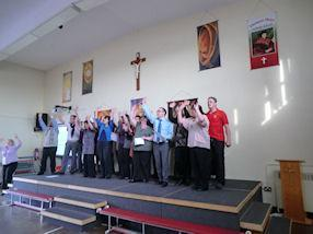 The staff singing 'Ain't No Mountain High Enough'.