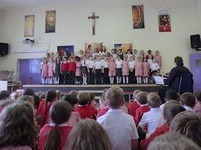The school choir sing some songs from Lion King