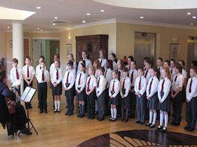 The choir begin their performance.
