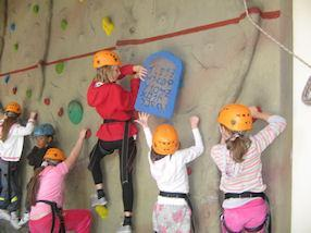 Rock climbing on the indoor wall.