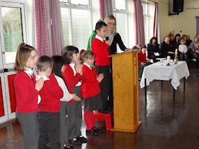 Children lead the Bidding Prayers.