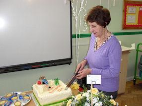 Essie cutting her retirement cake.