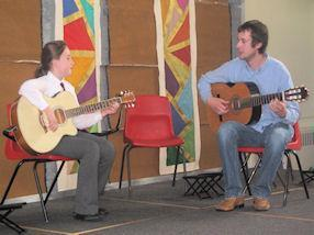 Guitar duet with pupil and tutor.