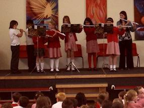 Year 5 pupils playing in a flute ensemble.