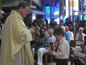 His first Holy Communion.